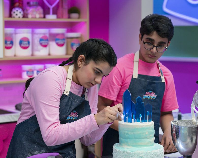 """Seattle-area teens Zahira Amarsi and Amar Deshpande are in the episode of """"Disney's Magic Bake-Off"""" airing 8 p.m. Sept. 24. (Aaron Epstein / Disney)"""
