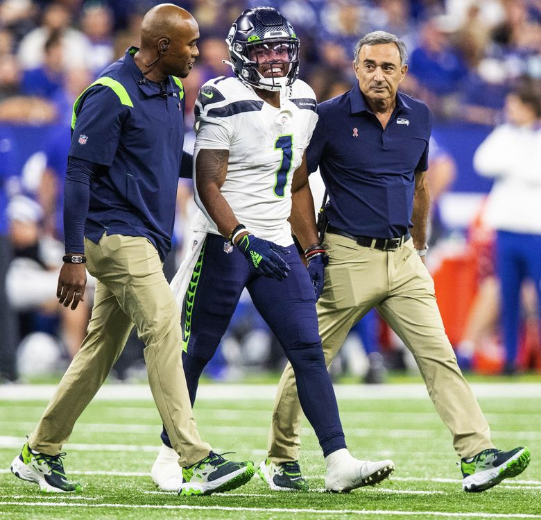 Dee Eskridge leaves the 2021 season opening game with an injury against the Colts in Indianapolis, Sept. 12, 2021. (Dean Rutz / The Seattle Times)