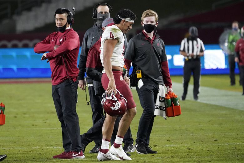 Jayden de Laura walks off the field after an injury during the second half during a game against USC in Los Angeles, Dec. 6, 2020. (Alex Gallardo / AP)