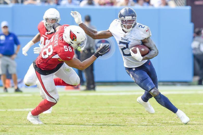 Julio Jones evades Arizona Cardinals middle linebacker Jordan Hicks during a game between the Tennessee Titans and Arizona Cardinals, Sept. 12, 2021, in Nashville, Tenn. (Mark Zaleski / AP)