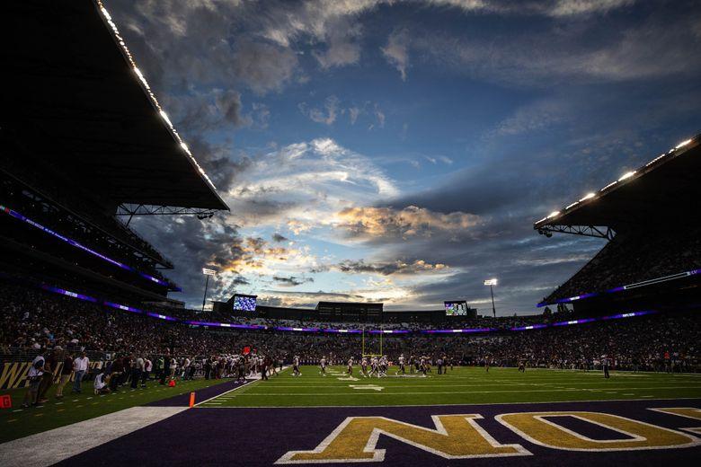 The sun sets on Husky Stadium, Sept. 4, 2021 in Seattle. (Dean Rutz / The Seattle Times)