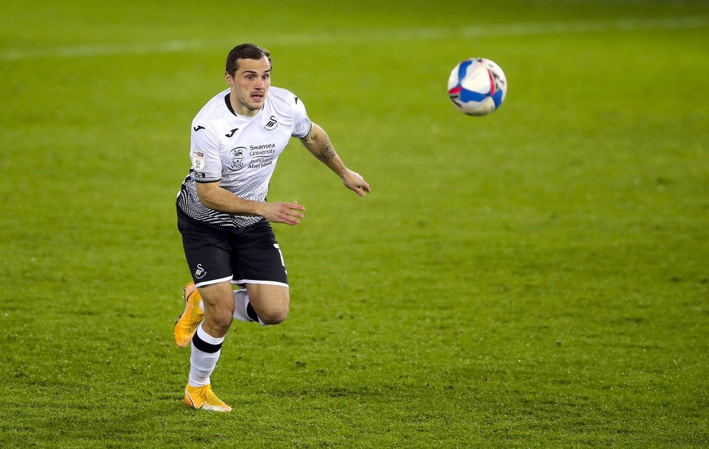 Swansea City's Jordan Morris chases down the ball during an English Championship soccer match against Norwich City at Liberty Stadium, in Swansea, Wales, Feb. 5, 2021. (Nick Potts / PA via AP)