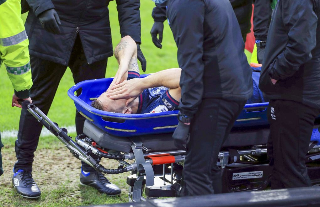 Swansea City's Jordan Morris is stretchered off the field after getting injured during a Sky Bet Championship soccer match against Huddersfield, Feb. 20, 2021, at John Smith's Stadium in Huddersfield, England. (Mike Egerton / PA via AP)