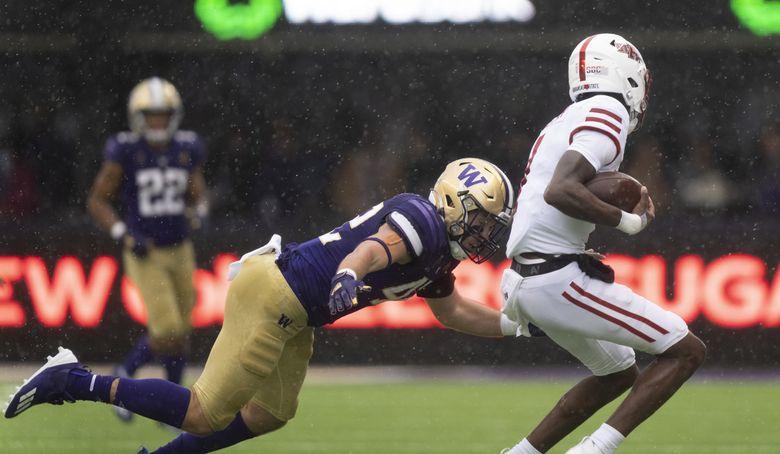 Washington linebacker Carson Bruener tackles Arkansas State quarterback James Blackman during an NCAA football game on Saturday, Sept. 18, 2021, in Seattle. Washington won 52-3. (AP Photo/Stephen Brashear)  (Stephen Brashear / The Associated Press)