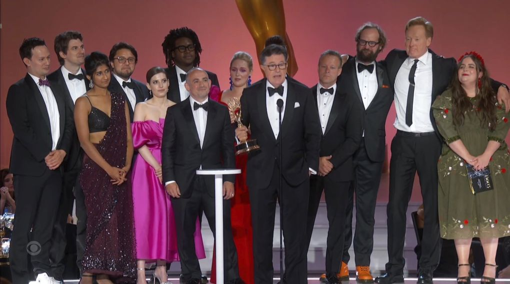 """Stephen T. Colbert, center, and the cast and crew of """"Stephen Colbert's Election Night 2020: Democracy's Last Stand Building Back America Great Again Better 2020"""" accept the award for outstanding variety special during the Primetime Emmy Awards. Joining them from right are presenter Aidy Bryant and Conan O'Brien. (Television Academy via  The Associated Press)"""