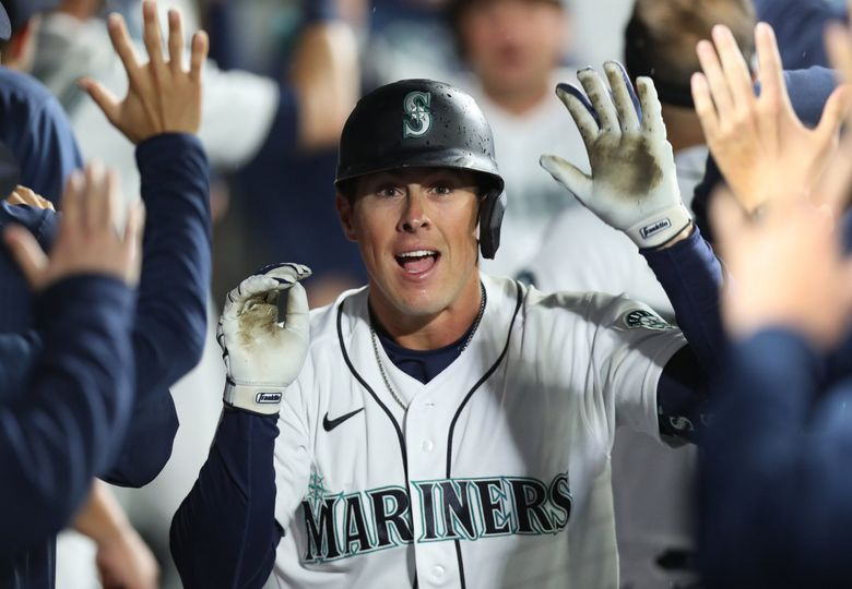 Mariners pinch hitter Dylan Moore is celebrated in the dugout after his two-run sixth inning go-ahead homer against the Astros, Monday, Aug. 30, 2021 in Seattle. (Ken Lambert / The Seattle Times)