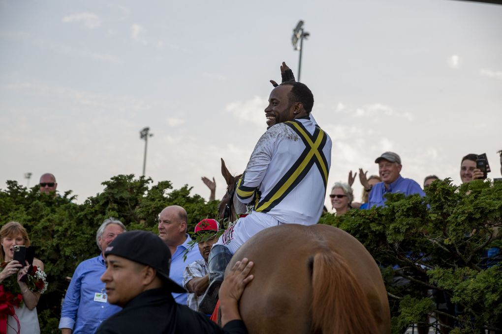 Background ridden by jockey Rocco Bowen wins at the 86th Longacres Mile Handicap, Aug. 15, at Emerald Downs in Auburn. (Sylvia Jarrus / The Seattle Times)