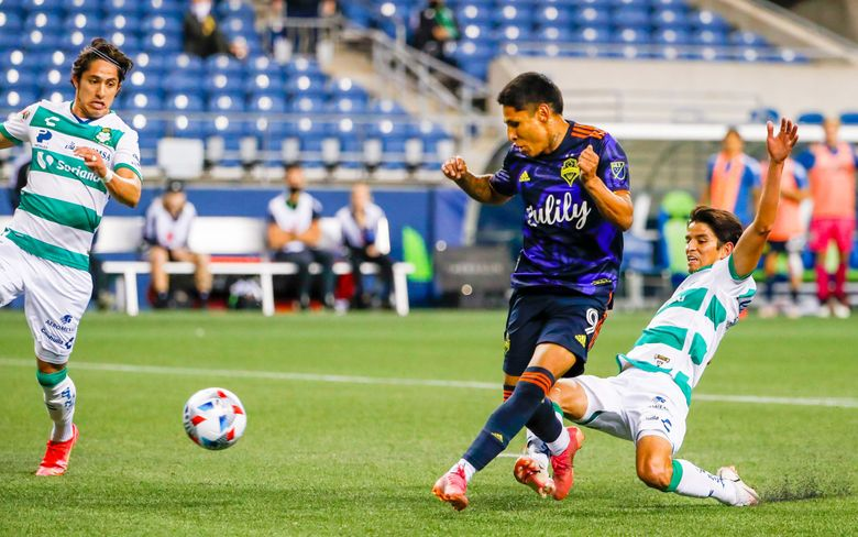 Raul Ruidiaz beats the Santos Laguna defense for the game winning goal in stoppage time during the Leagues Cup semifinal match, Sept. 14, 2021, in Seattle. (Jennifer Buchanan / The Seattle Times)