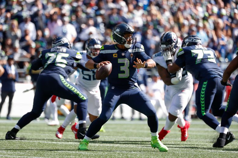 Russell Wilson passes during the first quarter against the Tennessee Titans, Sept. 19, 2021, in Seattle. (Jennifer Buchanan / The Seattle Times)