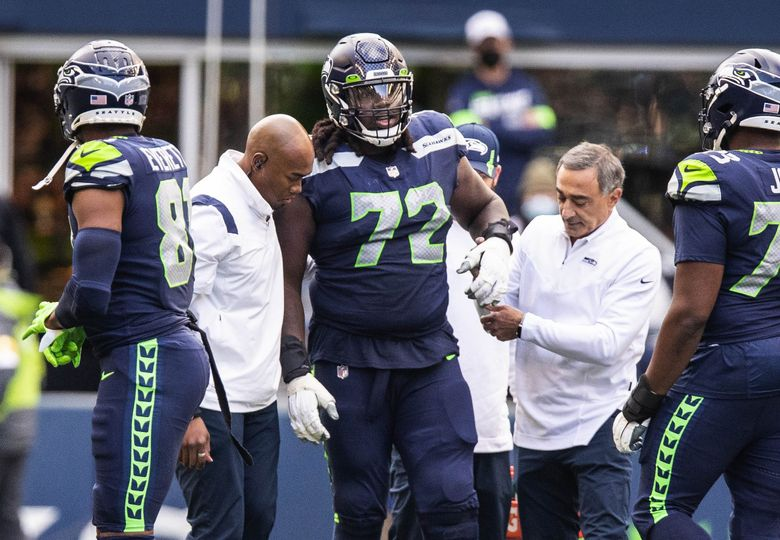 Tackle Brandon Shell goes out with an injury left Sunday's game against the Titans due to injury. (Dean Rutz / The Seattle Times)