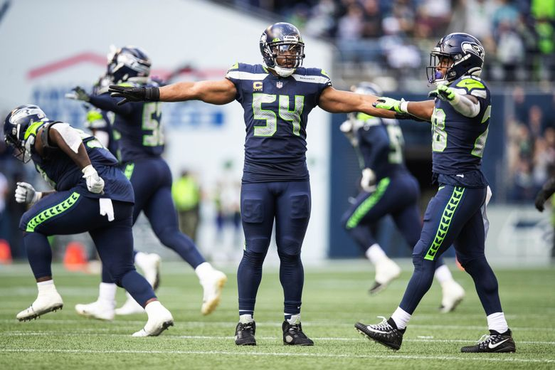 Bobby Wagner signals no-good on the Titans' field-goal try in the second half Sunday. (Dean Rutz / The Seattle Times)