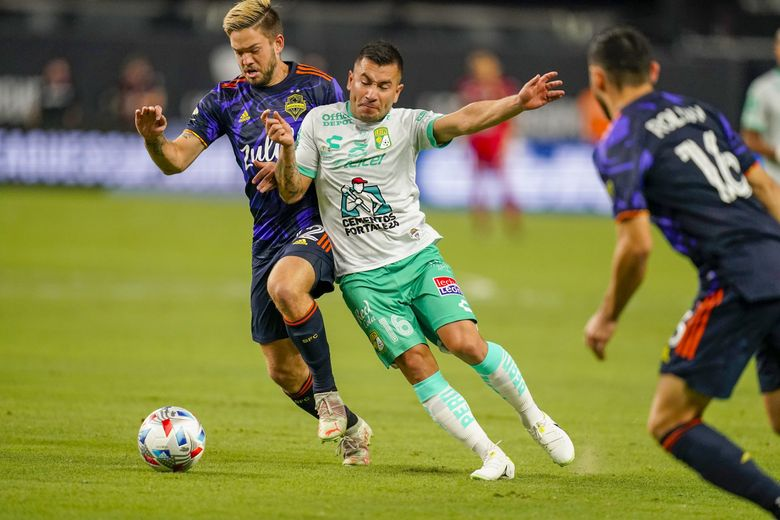 Kelyn Rowe and Club Leon's Jean Meneses (16) battle for the ball during the first half of the Leagues Cup final, Sept. 22, 2021, in Las Vegas. (John Locher / AP)