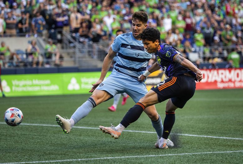 Fredy Montero gets position on Kansas City defender Andreu Fontas in the second half, and gets off a shot, but it misses its mark on July 25 at Lumen Field. (Dean Rutz / The Seattle Times)