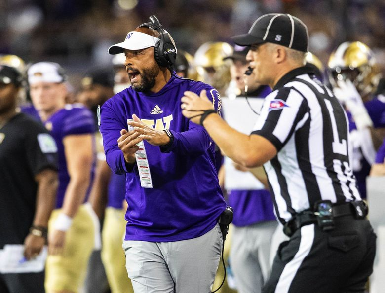 On 4th and 1 from the Cal 11, Washington coach Jimmy Lake runs over to the line judge and calls for a quick timeout.  The Huskies would convert, and go on to score their third touchdown on the half. (Dean Rutz / The Seattle Times)