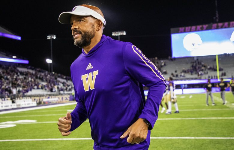Jimmy Lake runs off the field with an overtime victory over Cal. . The University of California Golden Bears played the Washington Huskies in Pac-12 Football Saturday, September 25, 2021 at Husky Stadium, in Seattle, WA. 218270