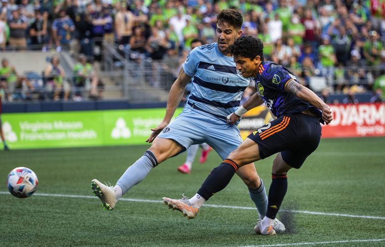 Fredy Montero gets position on Kansas City defender Andreu Fontas in the second half, and gets off a shot, but it misses its mark.  Sporting Kansas City played the Seattle Sounders in Major League Soccer Sunday, July 25, 2021 at Lumen Field in Seattle, WA. 217710