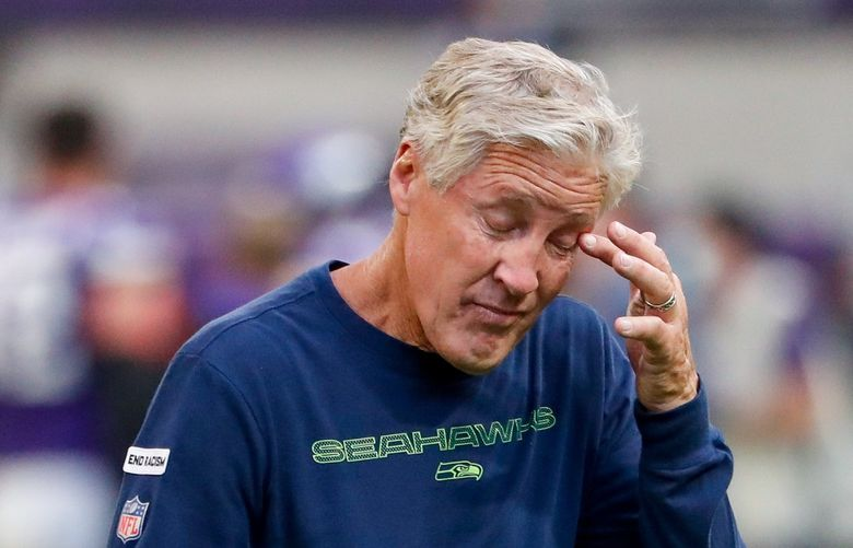 U.S. Bank Stadium – Seattle Seahawks at Minnesota Vikings – 092621  Seattle Seahawks head coach Pete Carroll wipes his face as he leaves the field after a loss to the Minnesota Vikings Sept. 26, 2021, in Minneapolis. 218322
