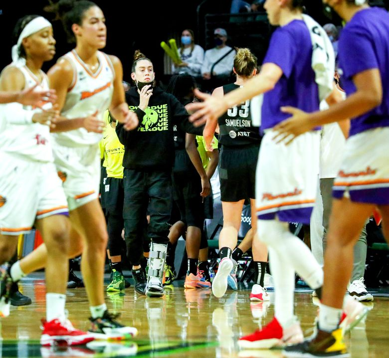 The Storm's Breanna Stewart, center, is seen during a timeout through Phoenix Mercury players during a close second half playoff game, Sept. 26, 2021 in Everett. (Ken Lambert / The Seattle Times)