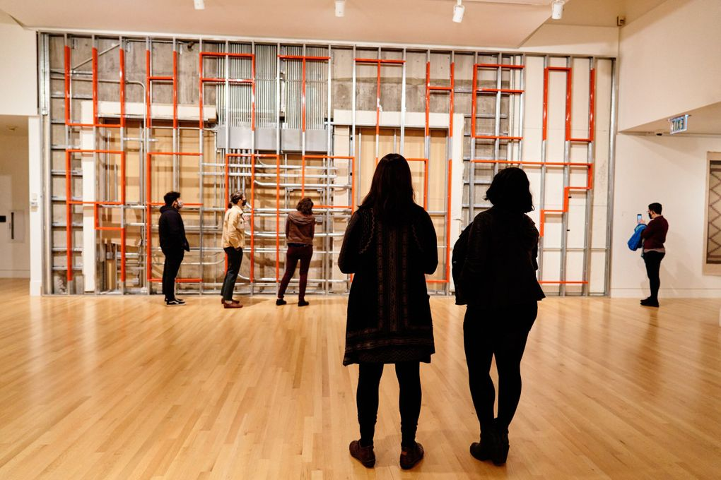 """Visitors to the Frye Art Museum view Duane Linklater's """"What Then Remainz."""" (Jonathan Vanderweit)"""