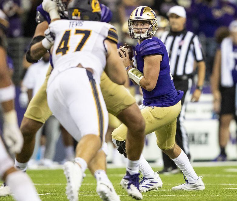 Washington quarterback Dylan Morris looks for a pass during the Huskies game against Cal, Sept. 25, 2021 in Seattle. (Amanda Snyder / The Seattle Times)