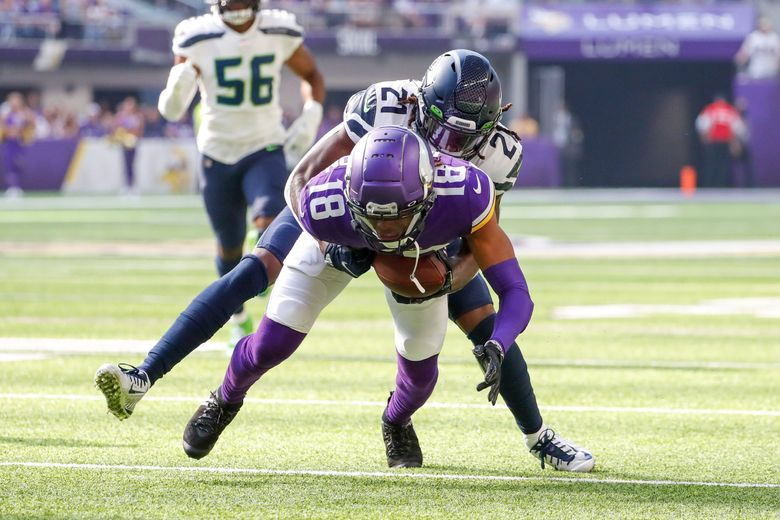 Tre Flowers tries to contain Minnesota Vikings wide receiver Justin Jefferson during the first quarter, Sept. 26, 2021, in Minneapolis. (Jennifer Buchanan / The Seattle Times)