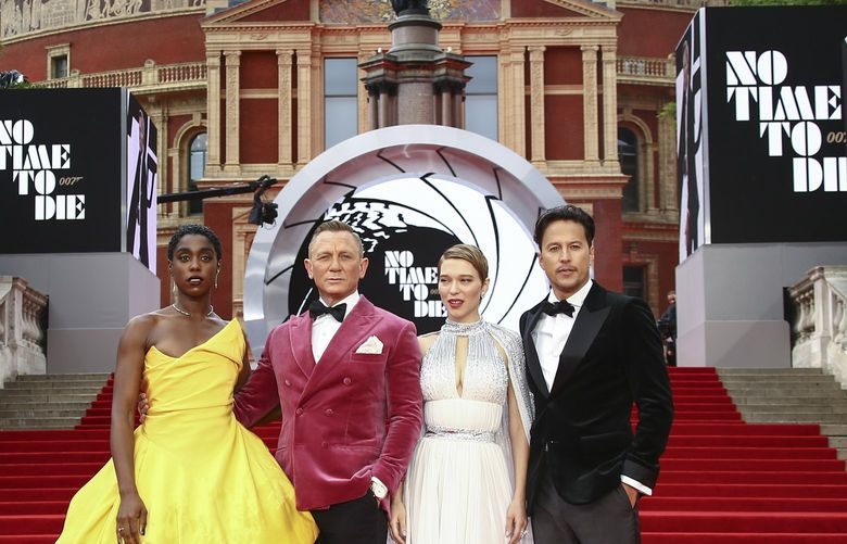 Lashana Lynch, from left, Daniel Craig, Lea Seydoux and Cary Joji Fukunaga pose for photographers upon arrival for the World premiere of the new film from the James Bond franchise 'No Time To Die', in London Tuesday, Sept. 28, 2021. (Photo by Joel C Ryan/Invision/AP) LENT165 LENT165