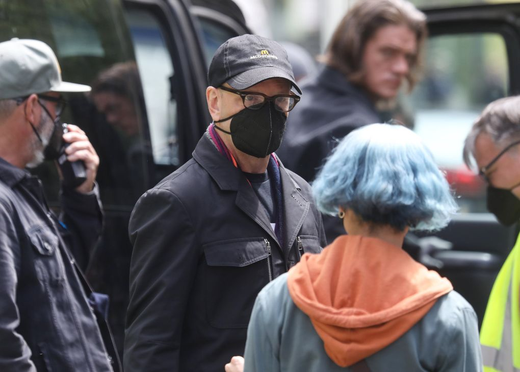 """Director Steven Soderbergh, center, talks with """"Kimi"""" star Zoë Kravitz while shooting in downtown Seattle in May. Interior scenes were shot in Los Angeles before the crew came to town to shoot outdoor scenes. (Ken Lambert / The Seattle Times)"""
