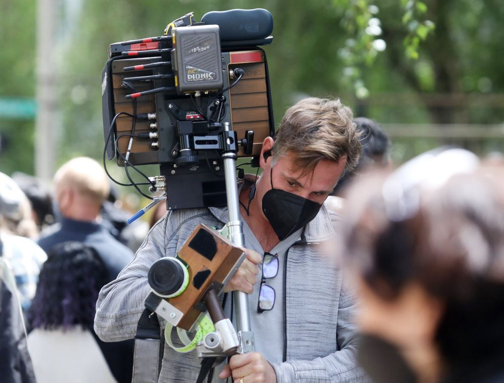"""Playback monitors are moved during filming for the movie """"Kimi"""" in May on Fifth Avenue in downtown Seattle. (Ken Lambert / The Seattle Times)"""