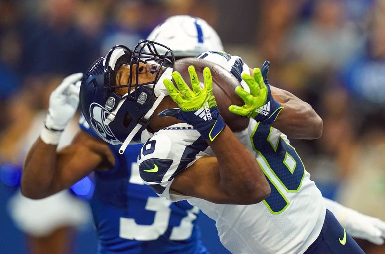 Seattle Seahawks wide receiver Tyler Lockett (16) makes a catch for a touchdown in front of Indianapolis Colts safety Khari Willis (37) in the first half Sunday. (Charlie Neibergall / AP)