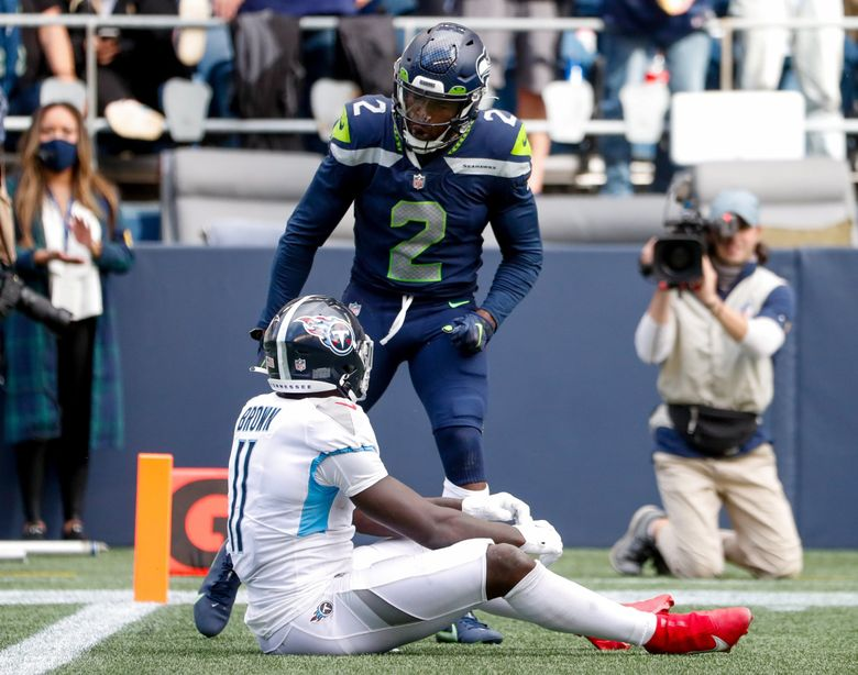 Seattle Seahawks cornerback D.J. Reed gets called for taunting after defending a pass intended for Tennessee Titans wide receiver A.J. Brown during the fourth quarter Sept. 19, 2021, in Seattle. (Jennifer Buchanan / The Seattle Times)