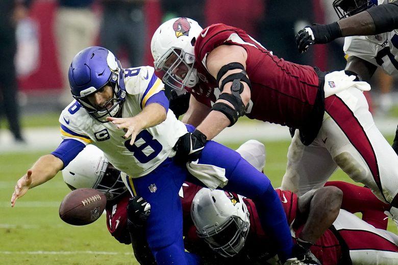 Minnesota Vikings quarterback Kirk Cousins recovers his own fumble as Arizona Cardinals linebacker Markus Golden and defensive end J.J. Watt (99) make the hit during the second half, Sept. 19, 2021, in Glendale, Ariz. (Ross D. Franklin / AP)