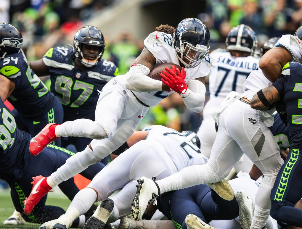 Tennessee running back Derrick Henry throws himself into the end zone on the 1-yard run, scoring the tying touchdown, ultimately sending the game into overtime. (Dean Rutz / The Seattle Times)