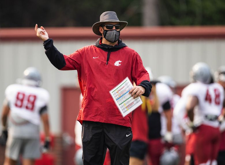 Coach Nick Rolovich watches his Cougars scrimmage, Aug. 12, 2021, in Pullman. (Dean Rutz / The Seattle Times)