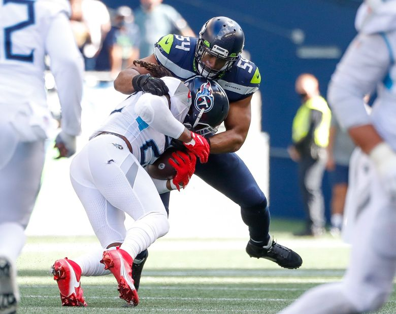 Tennessee Titans running back Derrick Henry runs into Seattle Seahawks middle linebacker Bobby Wagner during the third quarter Sept. 19, 2021, in Seattle. (Jennifer Buchanan / The Seattle Times)