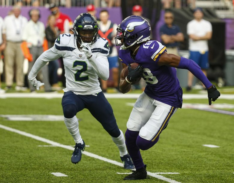 Minnesota Vikings wide receiver Justin Jefferson (18) runs past Seattle Seahawks cornerback D.J. Reed (2) in the first half of an NFL football game in Minneapolis, Sunday, Sept. 26, 2021. (Bruce Kluckhohn / The Associated Press)