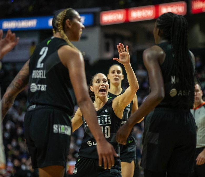 Sue Bird and the Storm react to a heads-up play by Ezi Magbegor, right, that gets her to the free throw line in the third quarter against the Phoenix Mercury, Sept. 17, 2021 in Everett. (Dean Rutz / The Seattle Times)