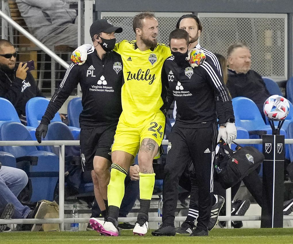 Stefan Frei is helped off the pitch after an injury during the closing moments of regular time against the Earthquakes in San Jose, Calif., May 12, 2021. (Tony Avelar / AP)