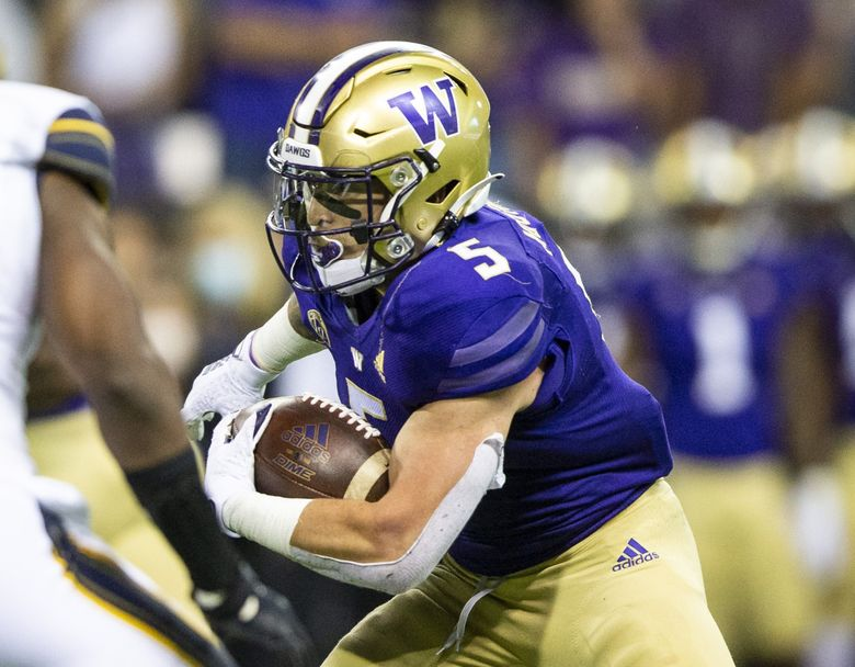 Washington's Sean McGrew runs for a touchdown against California in the fourth quarter at Husky Stadium on Saturday, Sept. 25, 2021. (Amanda Snyder / The Seattle Times)