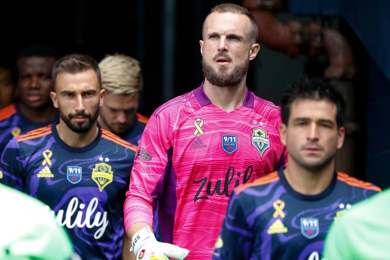 Seattle Sounders FC goalkeeper Stefan Frei marches out of the tunnel before the start of a game against Minnesota United FC, Sept. 11, 2021, in Seattle. (Jennifer Buchanan / The Seattle Times)