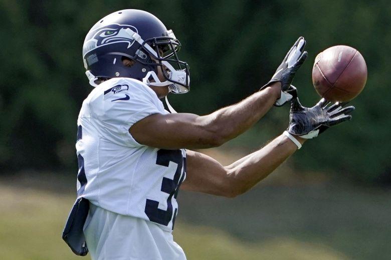 Seattle Seahawks cornerback John Reid runs a drill during training camp, Aug. 25, 2021, in Renton, Wash. (Ted S. Warren / AP)