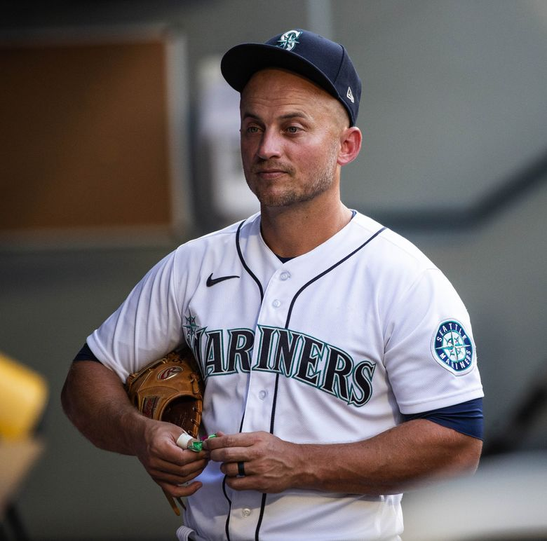 Kyle Seager in the dugout before a game the Houston Astros, July 27, 2021 in Seattle. (Dean Rutz / The Seattle Times)