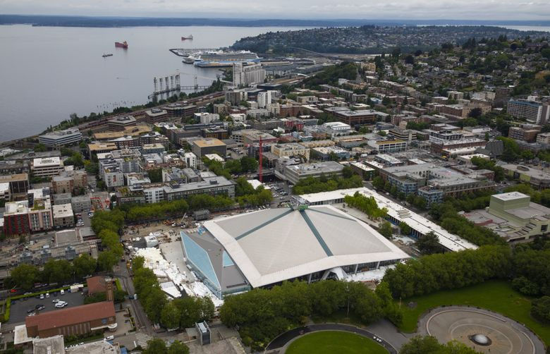 Work continues on Climate Pledge Arena in  Seattle in July. (Ellen M. Banner / The Seattle Times)