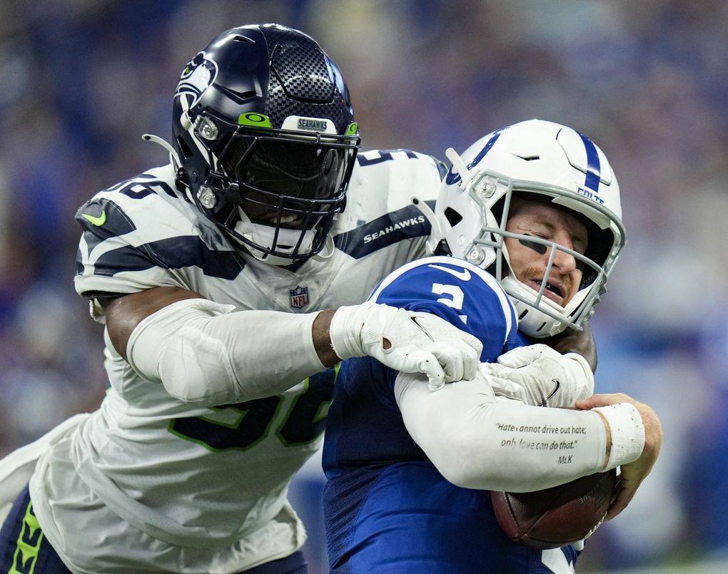Seahawks linebacker Jordyn Brooks sacks Colts quarterback Carson Wentz the second half Sunday. (AJ Mast / AP)