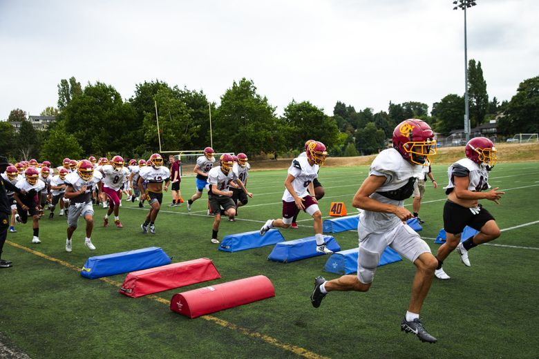 Players do agility drills during football practice for O'Dea High School at Genesee Park last month. (Bettina Hansen / The Seattle Times)