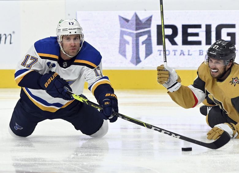 St. Louis Blues left wing Jaden Schwartz and Vegas Golden Knights Shea Theodore dive for the puck during a game, May 8, 2021, in Las Vegas. (David Becker / AP)