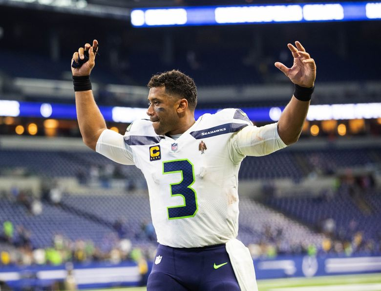 Russell Wilson celebrates Seattle's 28-16 win over Indianapolis with the 12s come to watch at Lucas Oil Stadium Sunday. The Seattle Seahawks played the Indianapolis Colts in NFL Football Sunday, Sept. 12, 2021 at Lucas Oil Stadium in Indianapolis. (Dean Rutz / The Seattle Times)