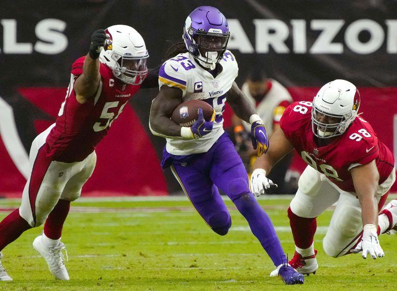 Minnesota Vikings running back Dalvin Cook rushes between two Cardinals defenders during their game in Arizona, Sept. 19, 2021. (Rick Scuteri / AP)