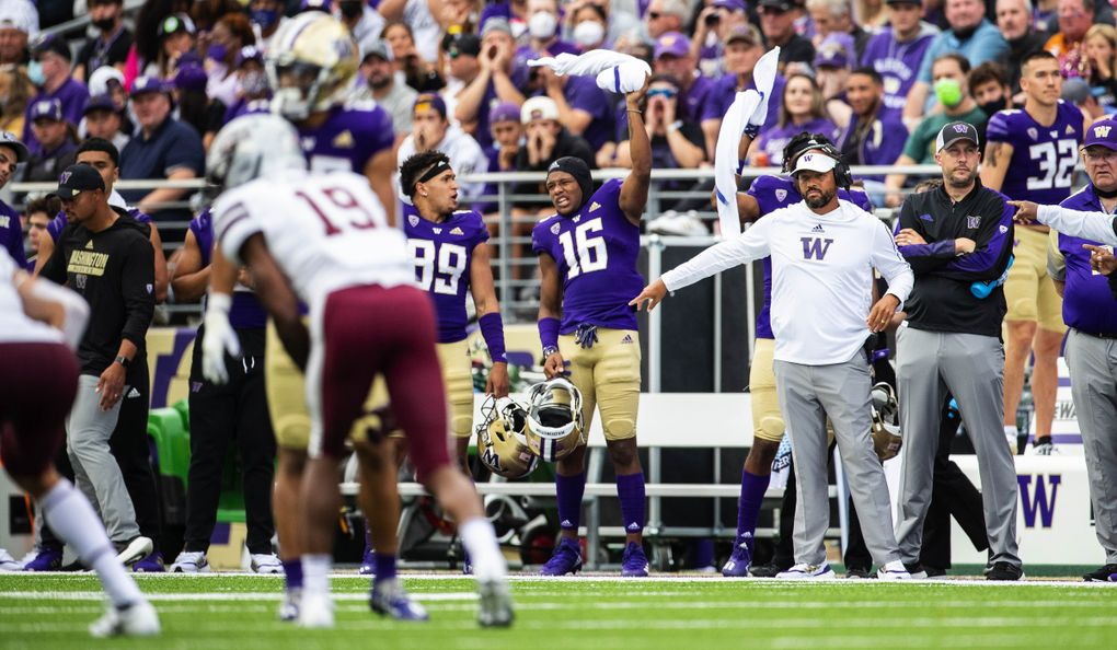 UW coach Jimmy Lake sets his defensive line in the first quarter against the Montana Grizzlies on Saturday, September 4, 2021 at Husky Stadium, in Seattle, WA. (Dean Rutz / The Seattle Times)