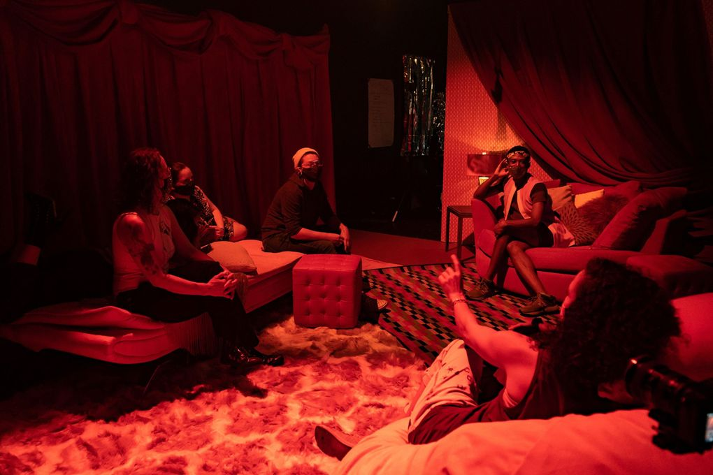 """Guests sit on couches during their guided experience of """"amber,"""" an interactive sensory installation at 12th Avenue Arts. """"Amber"""" is meant to be experienced in small groups though our writer enjoyed her solo journey through the exhibit. (Maria Manness)"""
