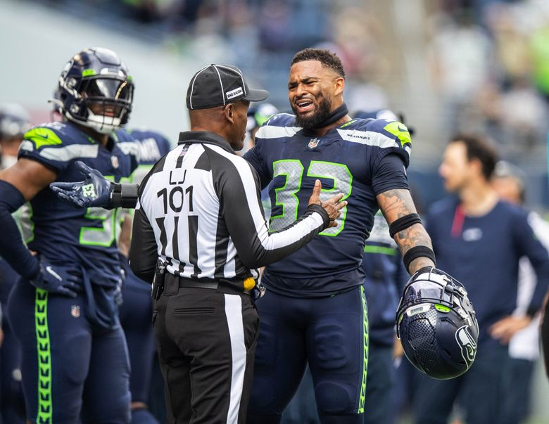 Seahawks safety Jamal Adams argues with an official Sunday. (Dean Rutz / The Seattle Times)